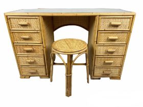 DRESSING TABLE/DESK, 1970's rattan and bamboo with ten drawers and a matching stool, 69cm H x