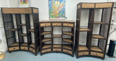CONCAVE OPEN DISPLAY SHELVES, a set of three, South East Asian rattan and hardwood, largest 129cm