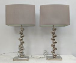 TABLE LAMPS, a pair, 70cm H including shades polished metal pebble design. (2)