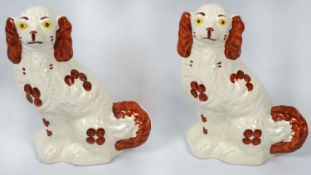STAFFORDSHIRE DOG FIGURINES, a pair, Spaniels by Arthur Wood, hand painted ceramic, marked to