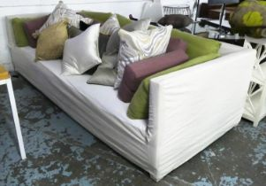 CHRISTIAN LIAIGRE SOFA, 276cm W with various slatter cushions, loose covers. (with faults)