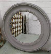 BRISSI CIRCULAR MIRROR, 79cm diam., in a grey distressed frame, with a circular bevelled plate.