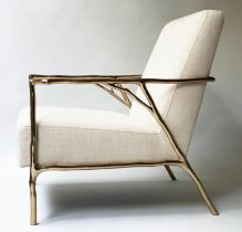 ARMCHAIR, contemporary solid brass framed, of branch form with parchment broadweave upholstery, 63cm