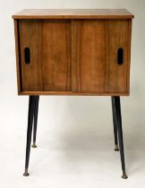 CABINET, 1960's teak with two doors, divisions and swept black brass tipped supports, 50cm W x