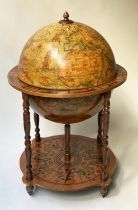 GLOBE COCKTAIL CABINET, in the form of an antique terrestrial globe with rising lid, 94cm H.