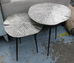 LILY PAD SIDE TABLES, a pair, graduated pair, 49cm x 53cm x 54cm at largest, polished metal tops. (