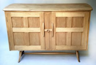 ERCOL SIDEBOARD, mid 20th century, solid elm, in Arts and Crafts style, with two panelled doors,