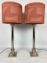INDIA JANE COLUMN LAMPS, a pair, silvered metal, with abstract design shades, 100cm H. (2)
