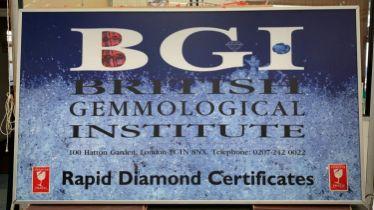 BGI ADVERTISING SIGN, 116cm H x 207cm W, back lit, encased in a metal frame.