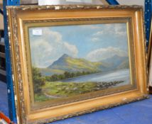 FRAMED OIL ON CANVAS - SHEEP BY A LOCH SIDE, SIGNED T. FARMER ANDERSON, 1902