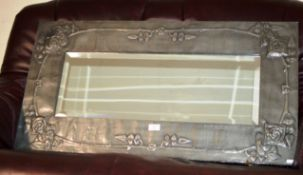 ARTS & CRAFTS PEWTER FRAMED WALL MIRROR WITH BEVELLED GLASS IN THE STYLE OF MARGARET GILMOUR,