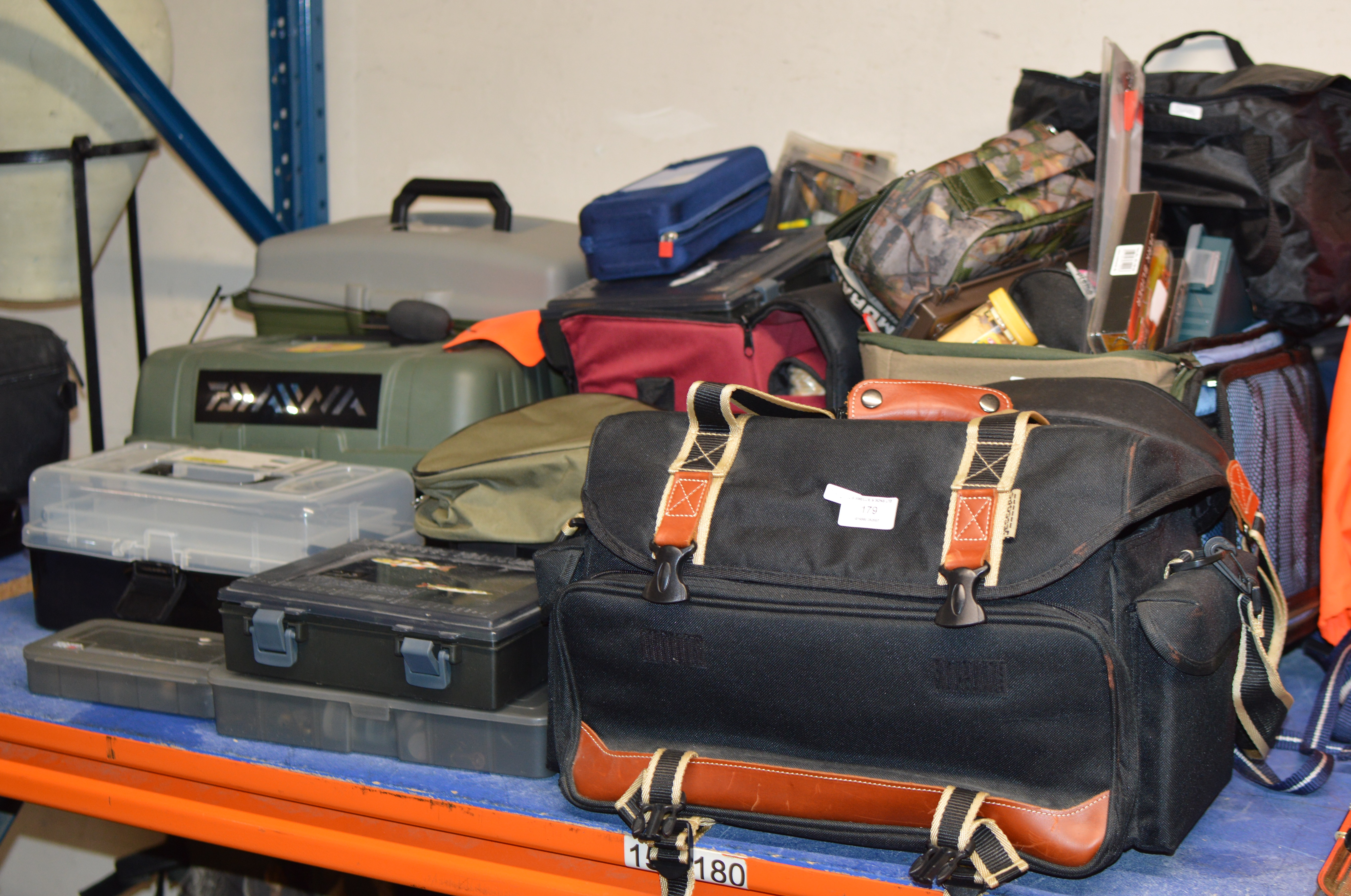 A LARGE QUANTITY OF ASSORTED FISHING TACKLE OVER VARIOUS BAGS & TACKLE BOXES, LURES, FLOATS,