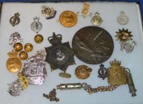 DISPLAY CASE WITH VARIOUS MILITARY STYLE BADGES, REPRODUCTION DEATH PLAQUE, WHISTLE ETC