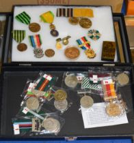 2 DISPLAY CASES WITH ASSORTED MEDALS