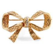 A diamond set bow brooch, Boucheron