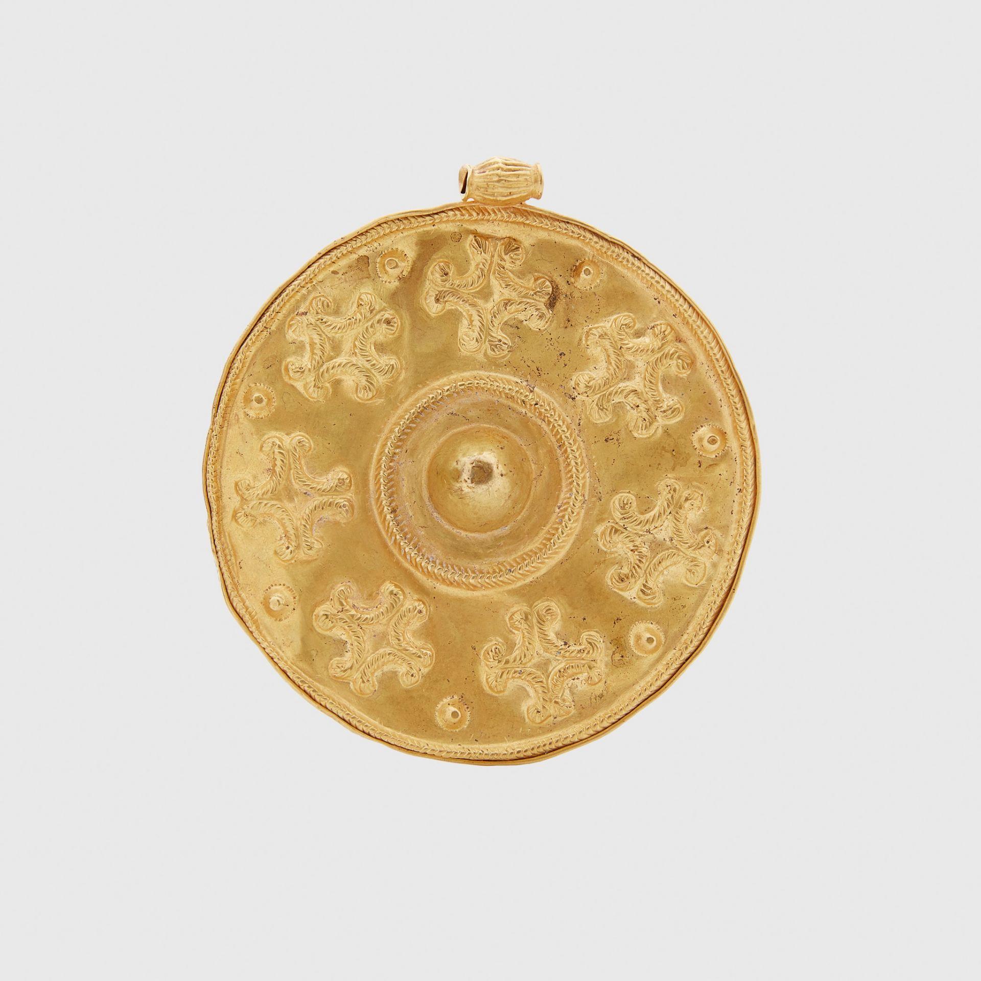 HELLENISTIC GOLD DISK PENDANT EASTERN MEDITERRANEAN, 1ST CENTURY A.D.