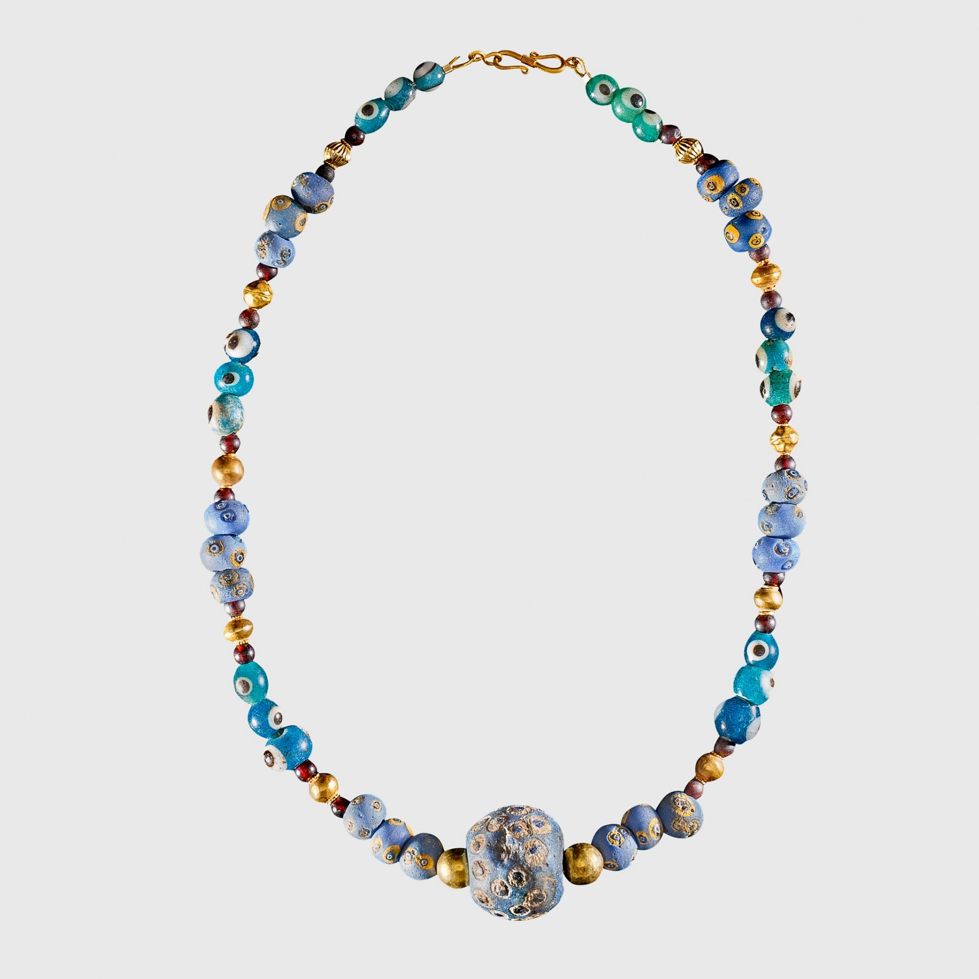 PHOENICIAN EYE GLASS AND GOLD BEAD NECKLACE NEAR EAST, C. 7TH CENTURY B.C.