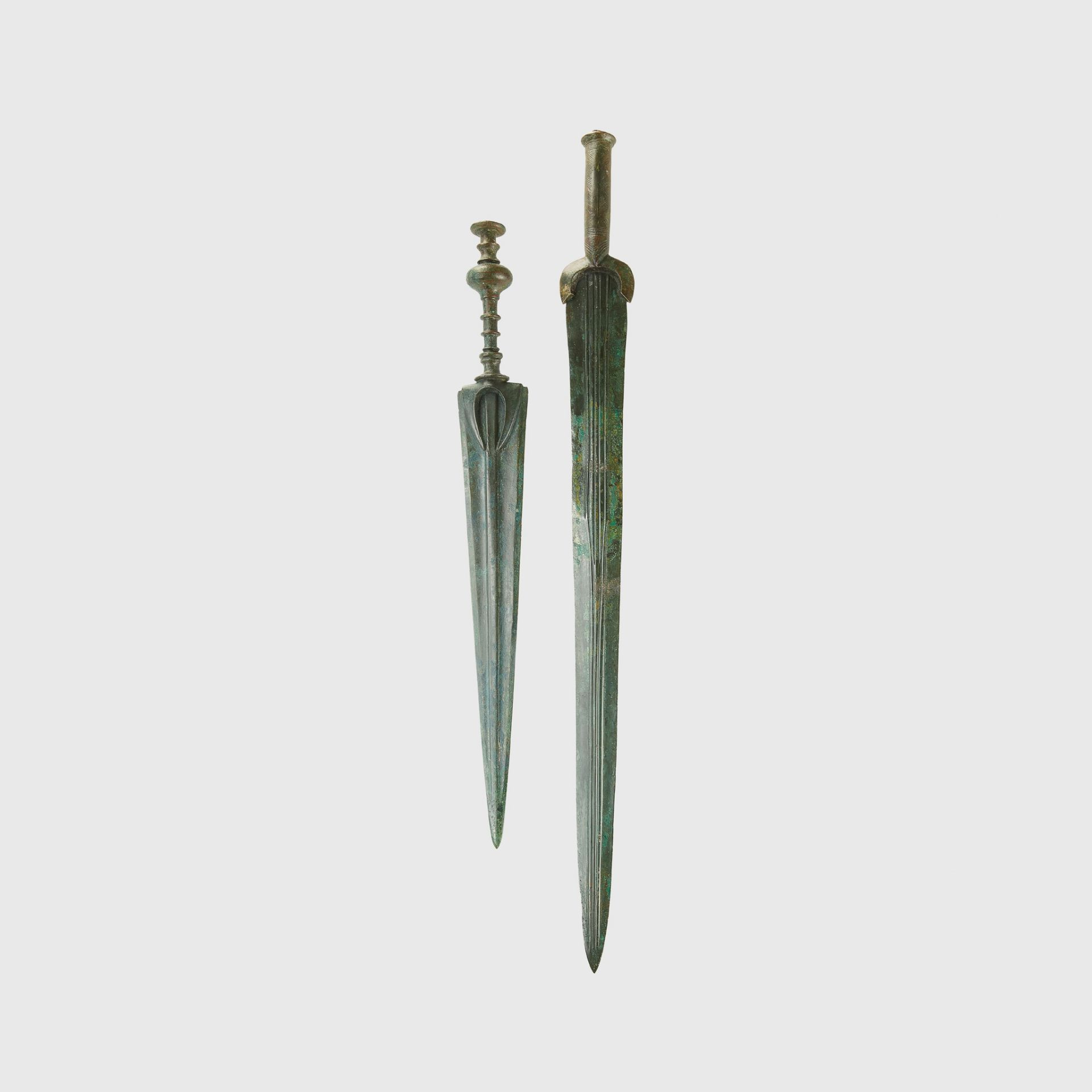 NEAR EASTERN DAGGER AND SWORD NEAR EAST, EARLY FIRST MILLENNIUM B.C.