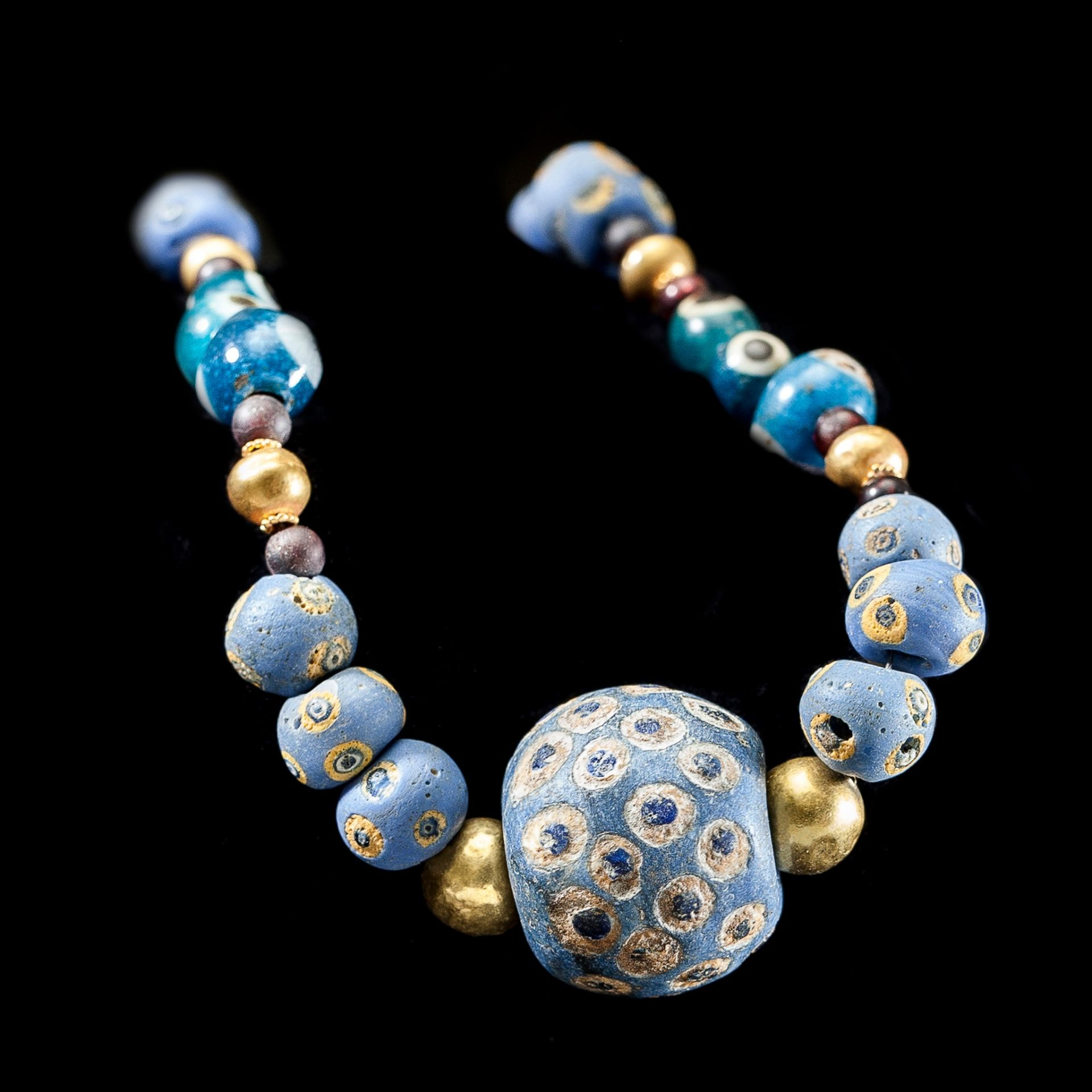 PHOENICIAN EYE GLASS AND GOLD BEAD NECKLACE NEAR EAST, C. 7TH CENTURY B.C. - Image 2 of 2