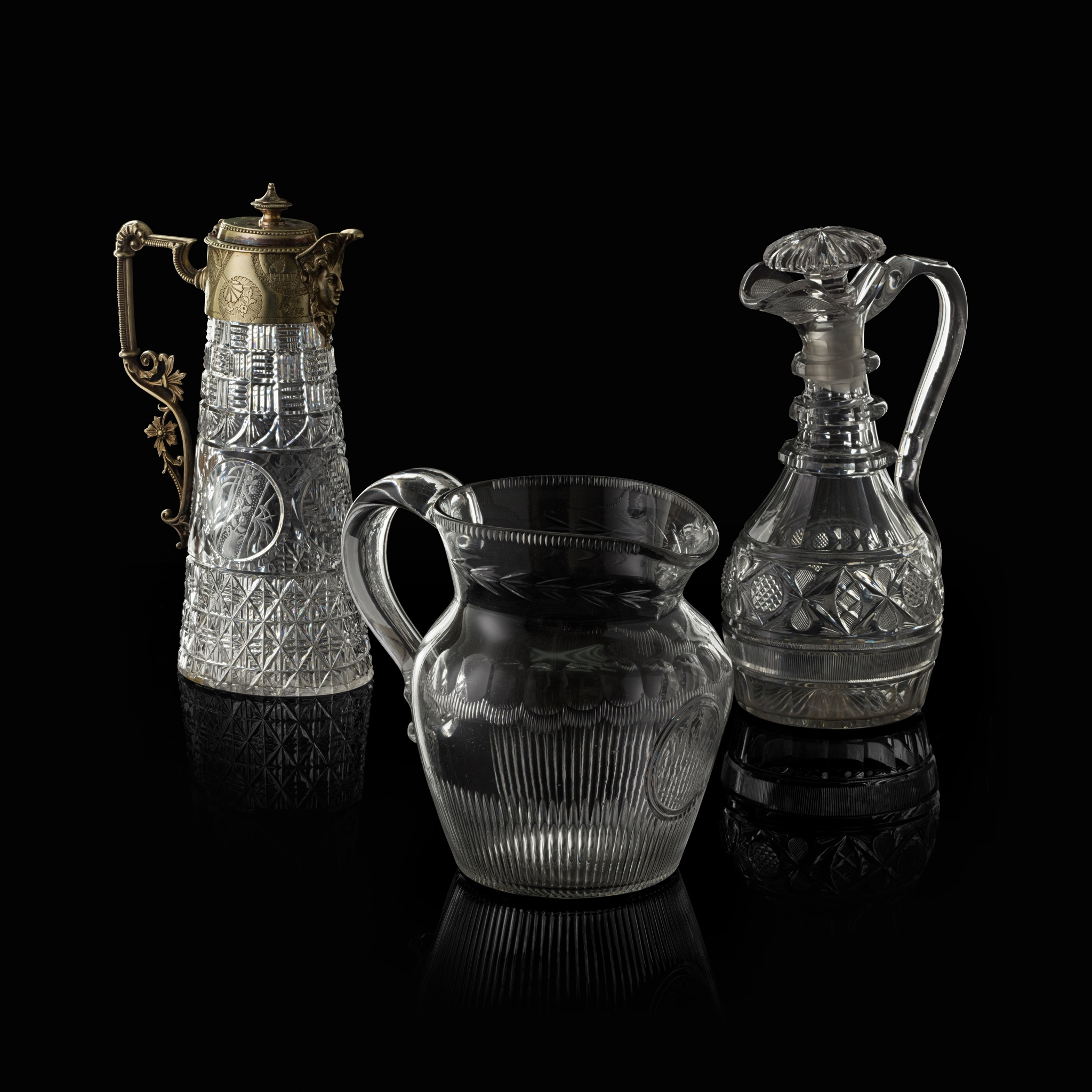 TWO CUT GLASS CLARET JUGS 19TH CENTURY