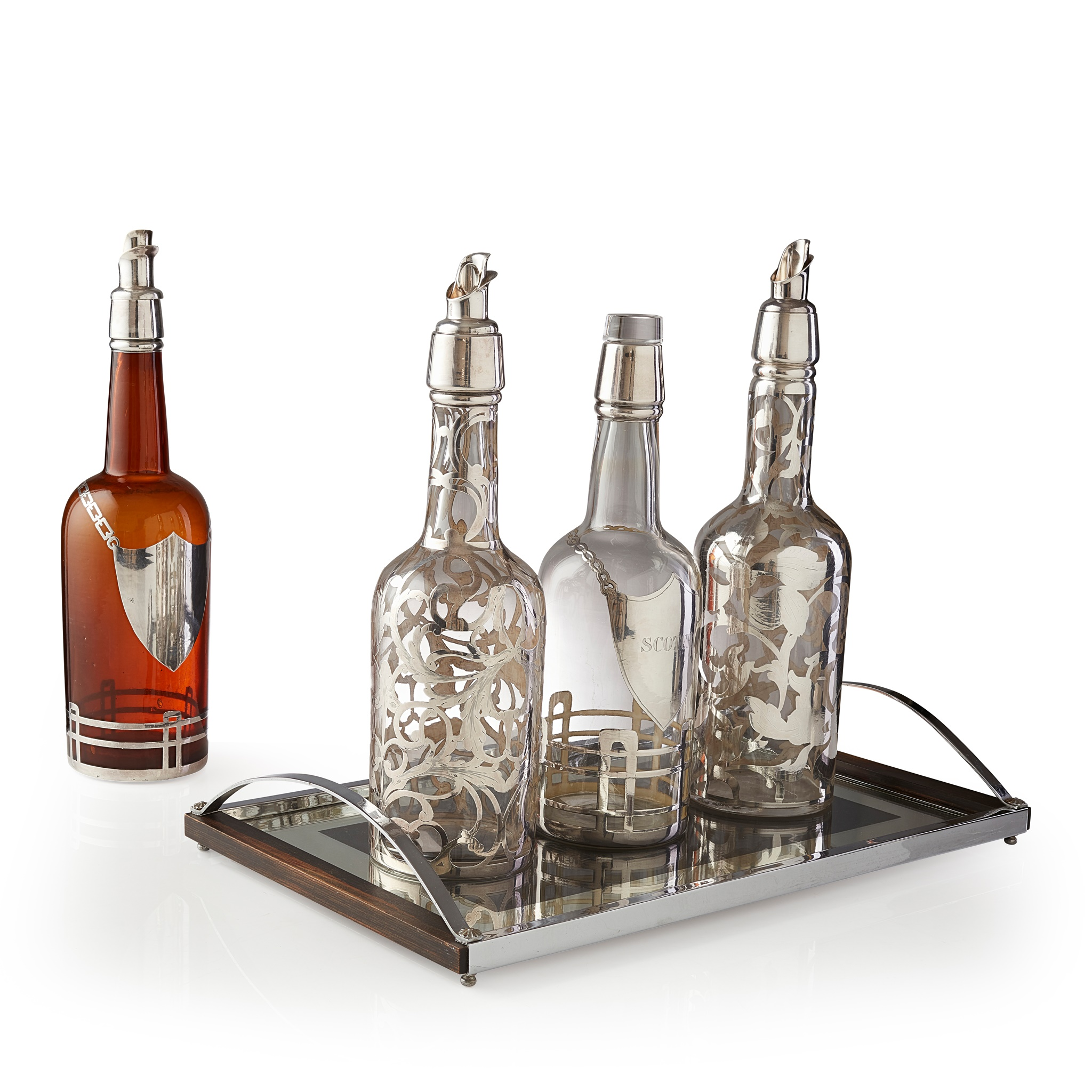 FOUR CONTINENTAL GLASS AND SILVER DECANTERS CIRCA 1930S