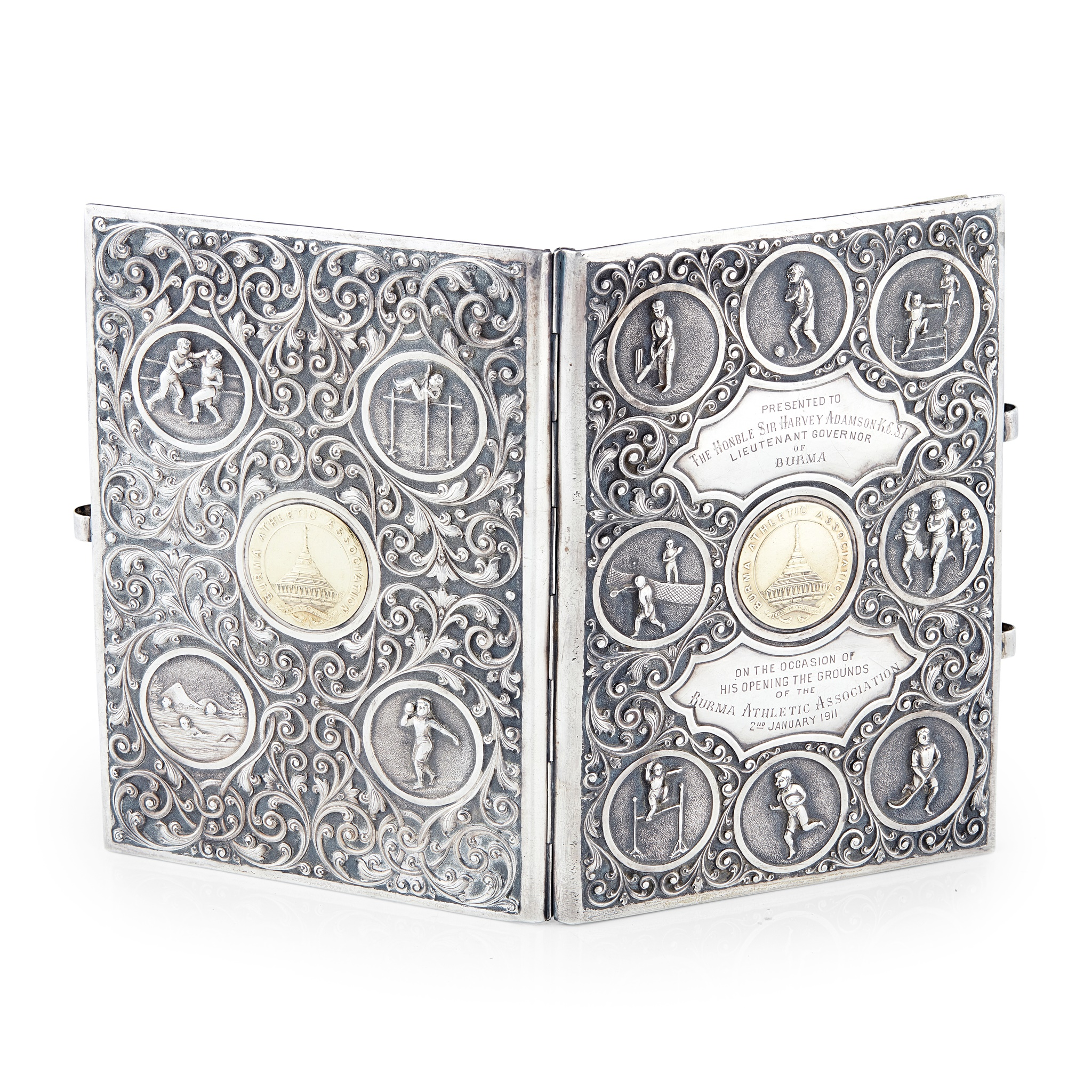 BURMESE SILVER AND SILVER GILT NOTEBOOK COVER, RELATING TO THE BURMA ATHLETIC ASSOCIATION DATED