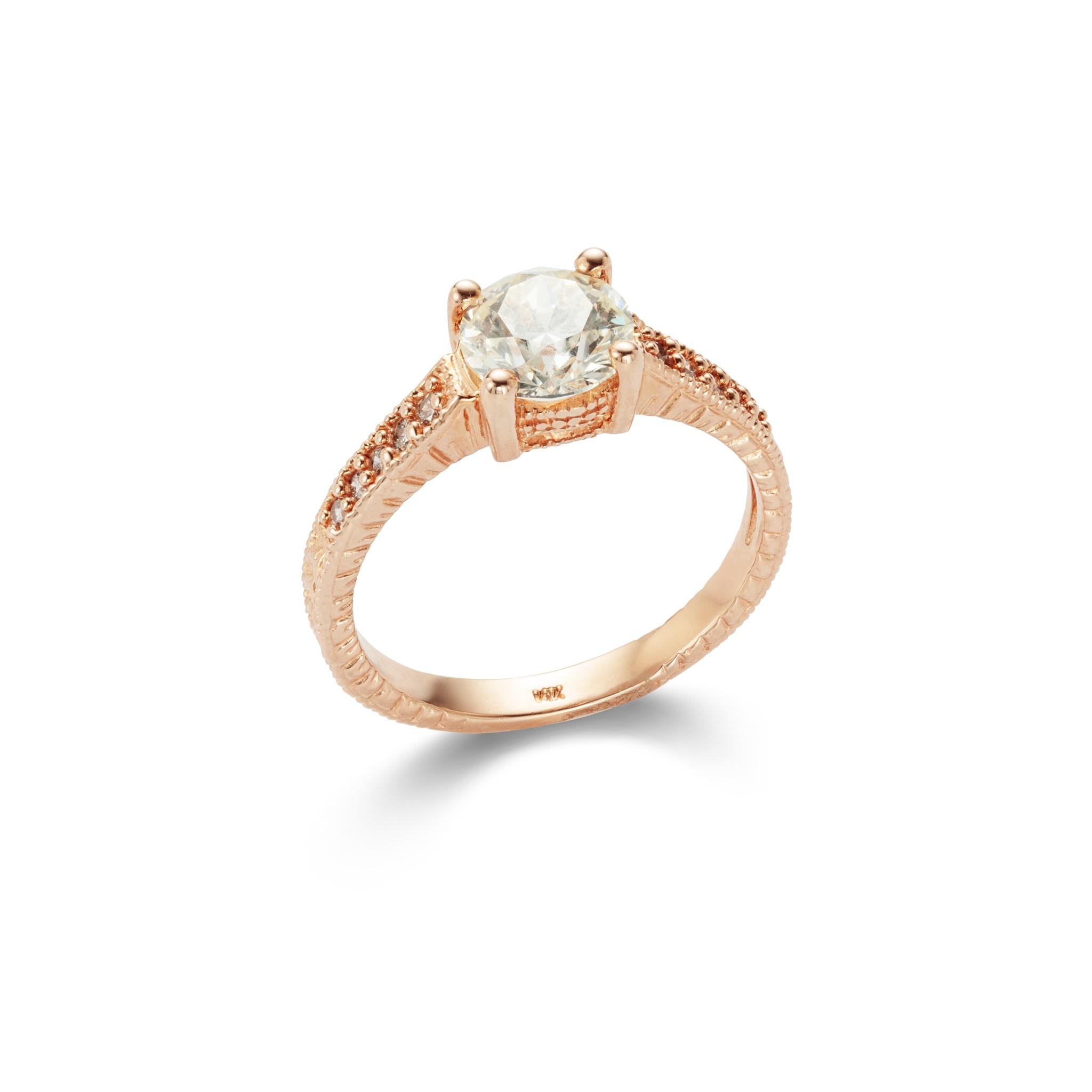 A diamond single-stone ring The brilliant-cut diamond between brilliant-cut diamond shoulders, to
