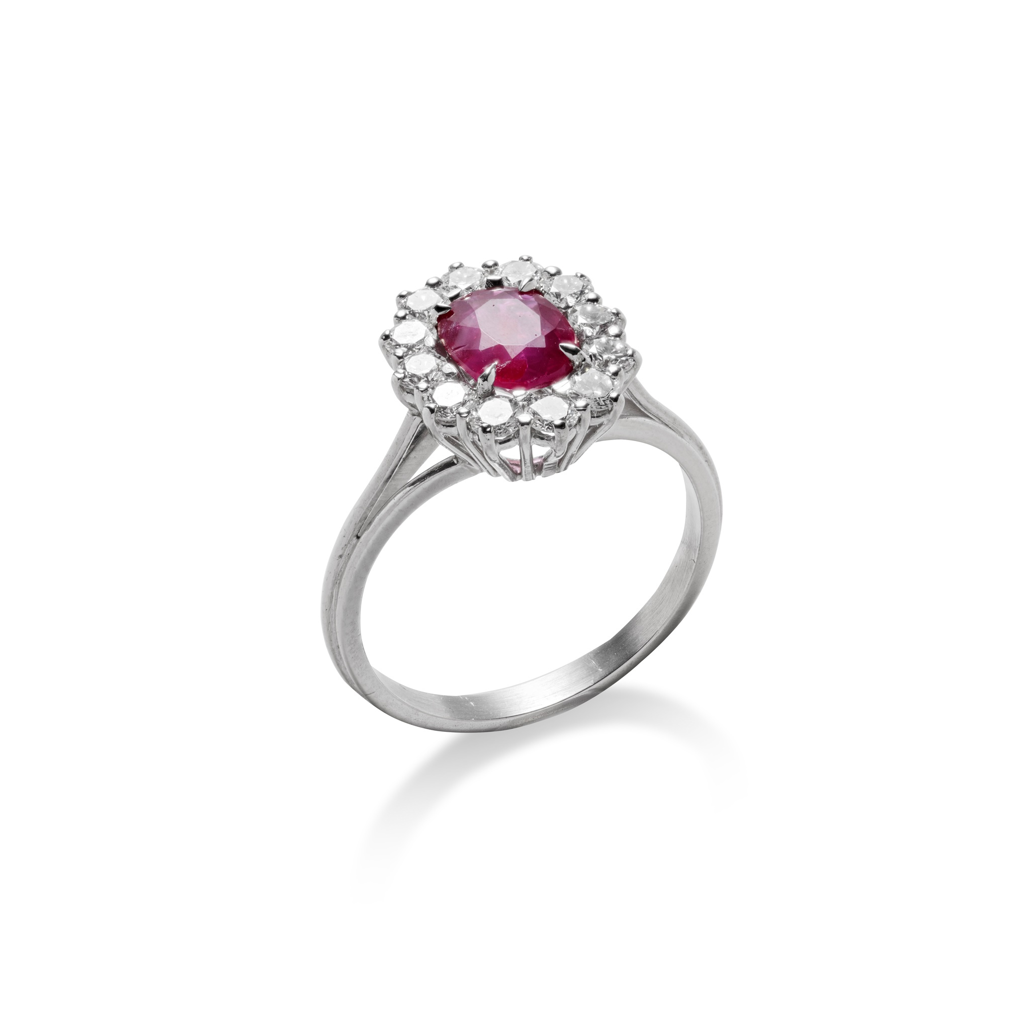 A ruby and diamond ring The oval-cut ruby, weighing 1.13 carats, within a brilliant-cut diamond