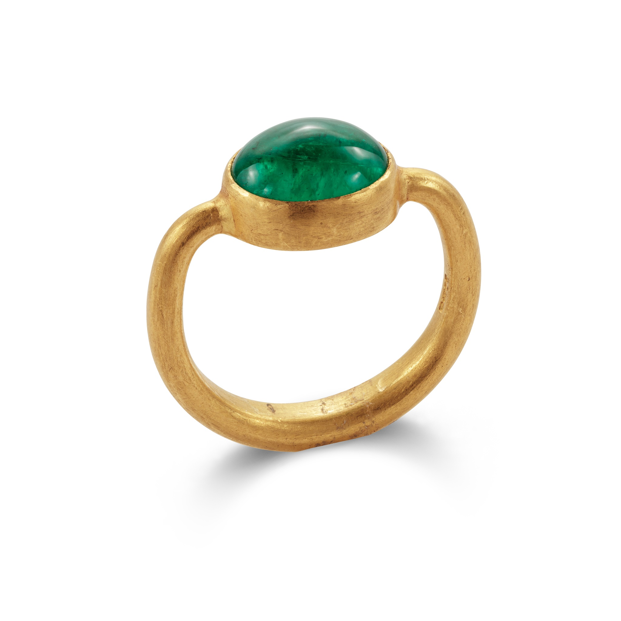 An emerald single-stone ring The oval cabochon emerald collet-set in a 22ct gold mount and hoop of