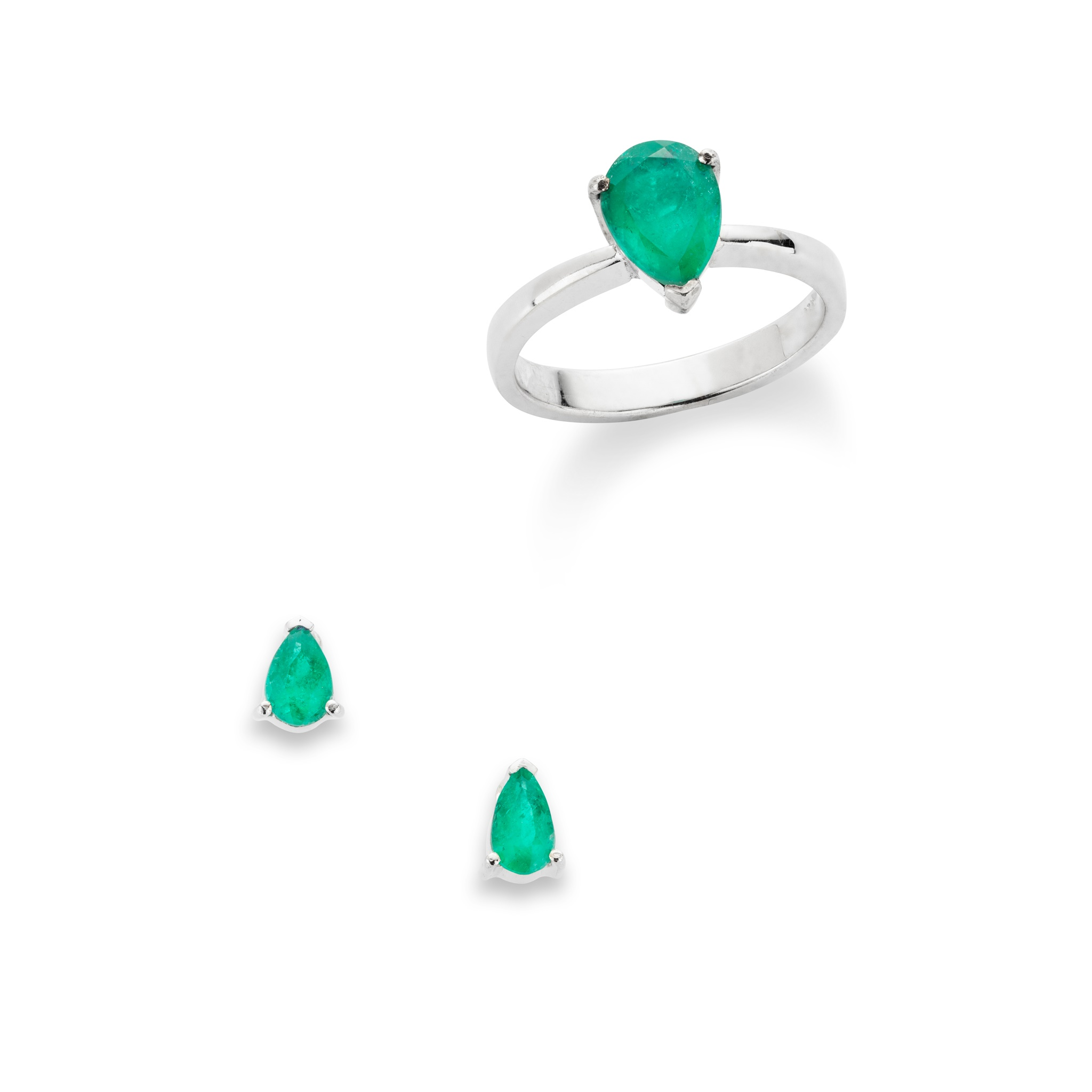 An emerald single-stone ring and pair of earrings Each set with a pear-shaped emerald in a three-