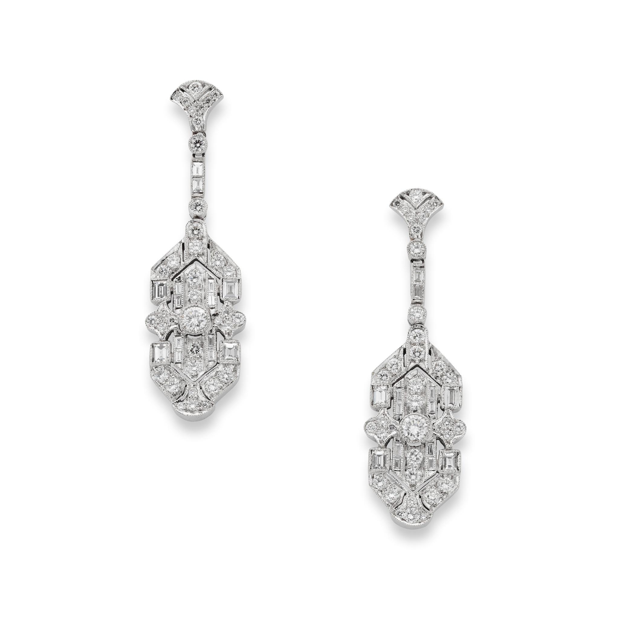 A pair of diamond pendent earrings Each suspending a pierced plaque of geometric design, set