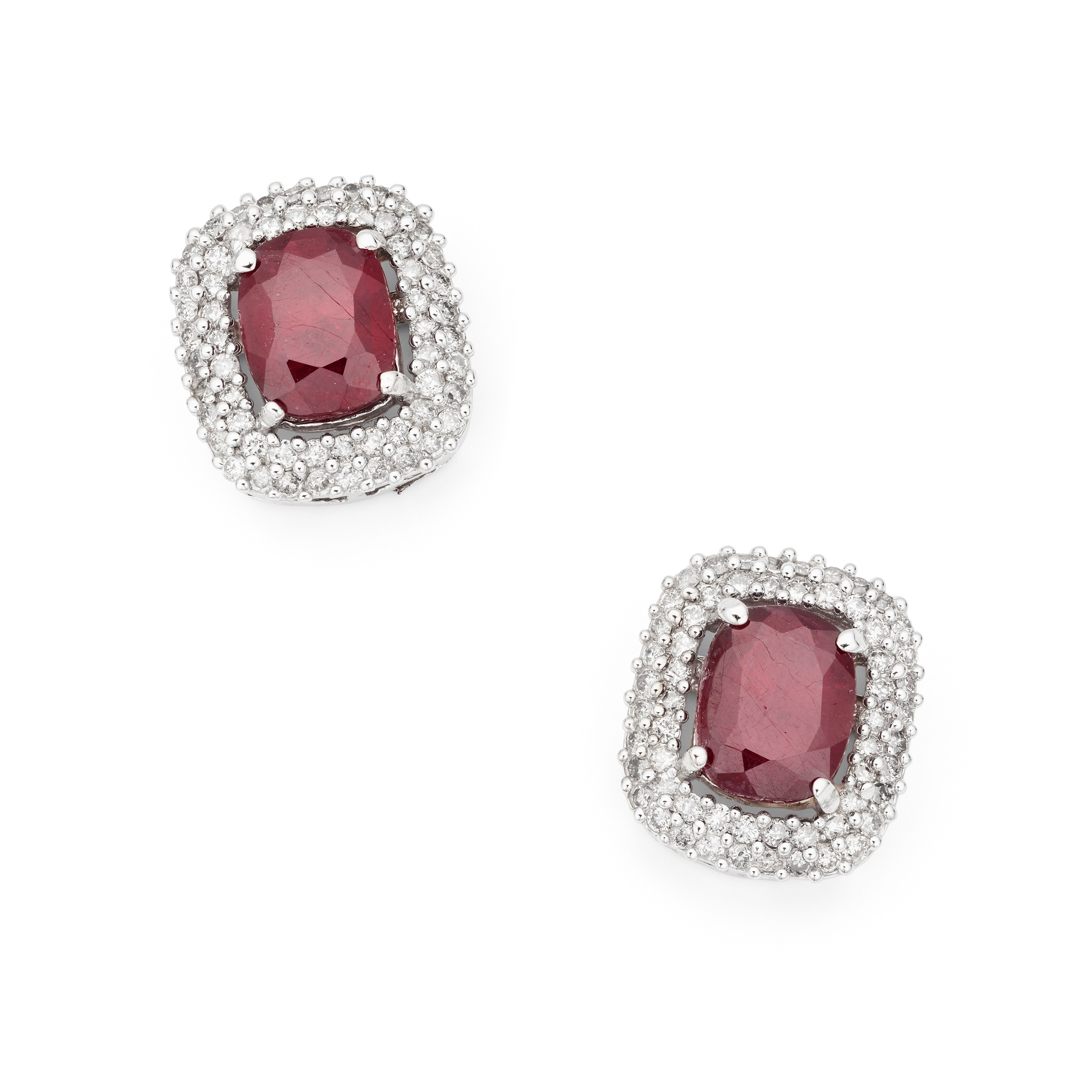 A pair of ruby and diamond earrings Each rectangular cushion-shaped ruby, within a two-row