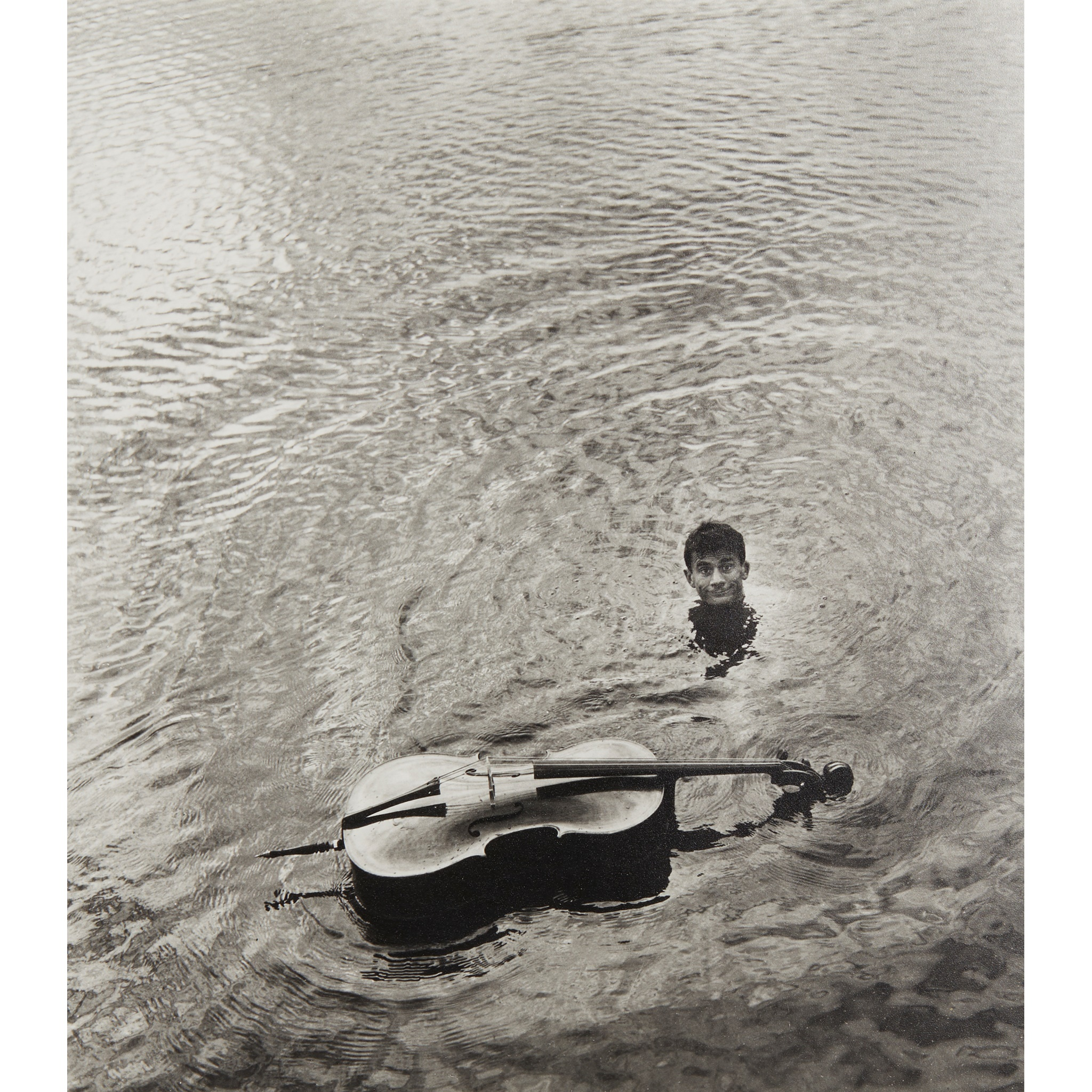 § ROBERT DOISNEAU (FRENCH 1912-1994) SABORDAGE - MAURICE BAQUET WITH HIS CELLO - 1957