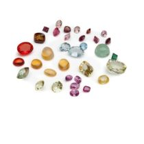 An unheated yellow sapphire and various loose gemstones