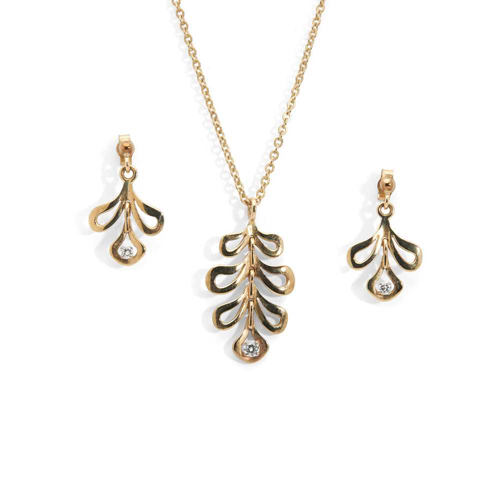 A diamond pendant necklace and matching earrings