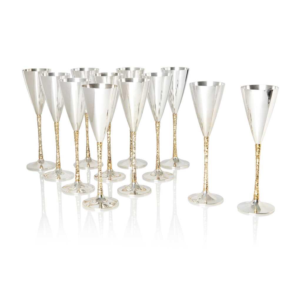 Stuart Devlin A.O. C.M.G. (Australian/British 1931-2018) Set of 12 Champagne Flutes, London 1977-198