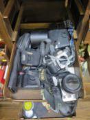 A Nikon D70 DSLR camera body, a Nikon F65 SLR camera body, other Praktica and Minolta cameras,