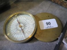 A 19th century brass cased pocket compass, with blued metal needle, the paper markers labelled J.