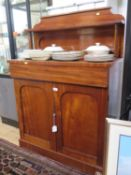 A mid Victorian mahogany chiffonier, the raised back with shelf over a long drawer and a pair of