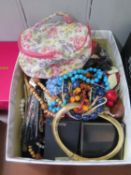 Box of costume jewellery with a Ronson lighter and small shovel