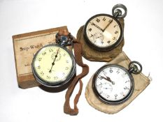 A gentleman's military pocket watch together with a stopwatch and another pocket watch