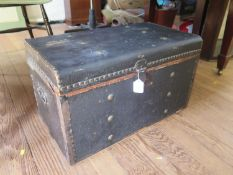 A fabric covered travelling trunk, 68 cm wide, 40 cm deep, 40 cm high