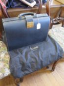 A Celine of Paris black leather briefcase, with compartments to the interior, unused and includes