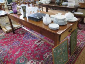 A 19th century French cherrywood dining table, the rectangular top with frieze drawer at either