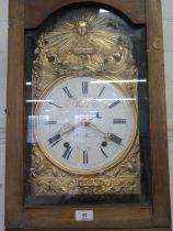 An 19th century French comtoise longcase clock, stained pine case with gilded repousse dial