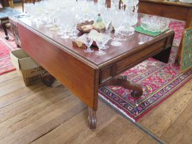 A William IV mahogany Pembroke table, with cushion moulded frieze and drawer on a square waisted