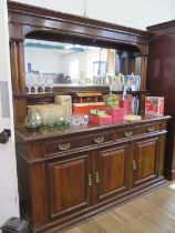 An Edwardian walnut mirror back sideboard, the moulded cornice over twin column supports and