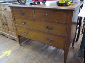 An Edwardian mahogany and satinwood crossbanded bedroom chest, with two short and two long drawers