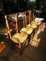 A set of six 19th century French ash ladderback dining chairs with rush seats, on turned legs and