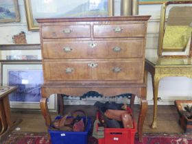 A George II crossbanded walnut chest on later stand, with two short and two long drawers on a